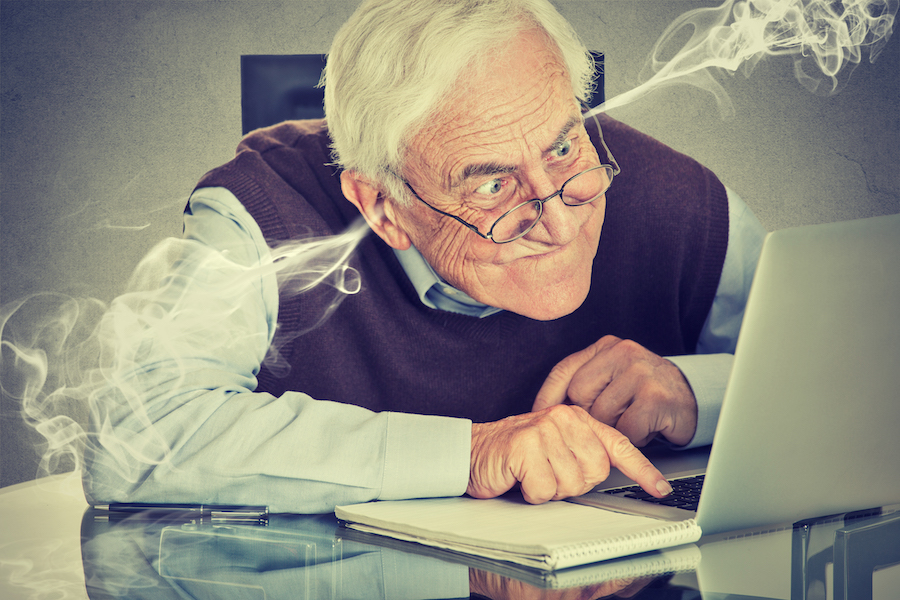 Elderly man on laptop, slow website