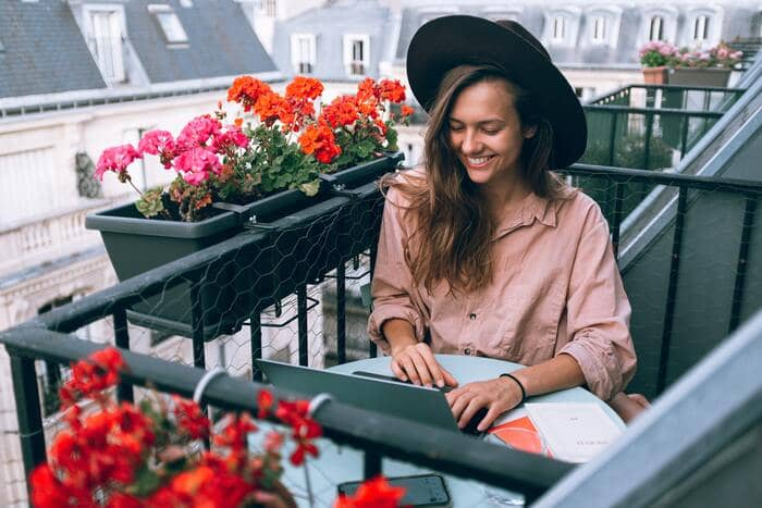 what is a freelancer woman working on scenic balcony