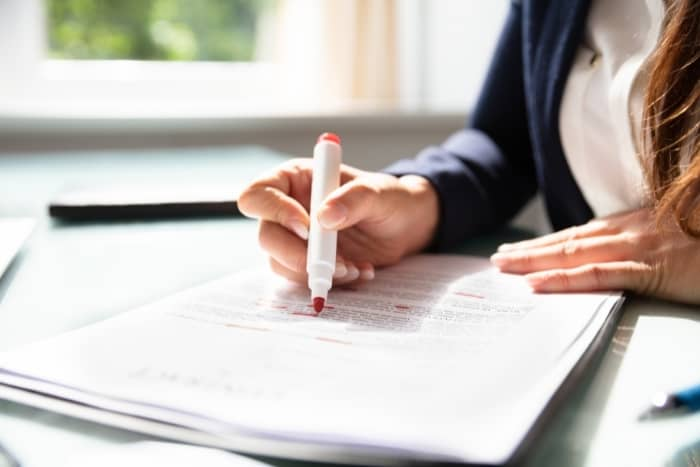 writing skills woman editing document